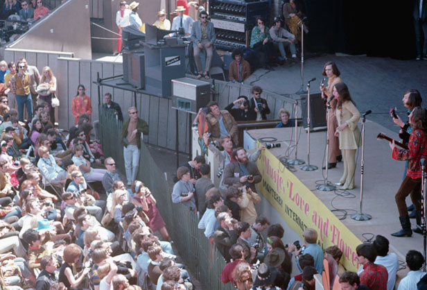 June 1967, Monterey, California, USA --- Janis Joplin with the guitarists of Big Brother and the Holding Company, on stage at the Monterey Pop Festival. The fame garnered from this performance caused Joplin to leave the band about a year later. --- Image by © Ted Streshinsky/CORBIS