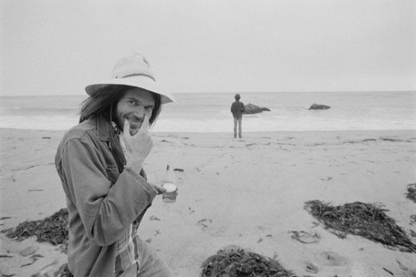 ca. 1975, Malibu, California, USA --- Musician Neil Young at the Beach --- Image by © Henry Diltz/CORBIS